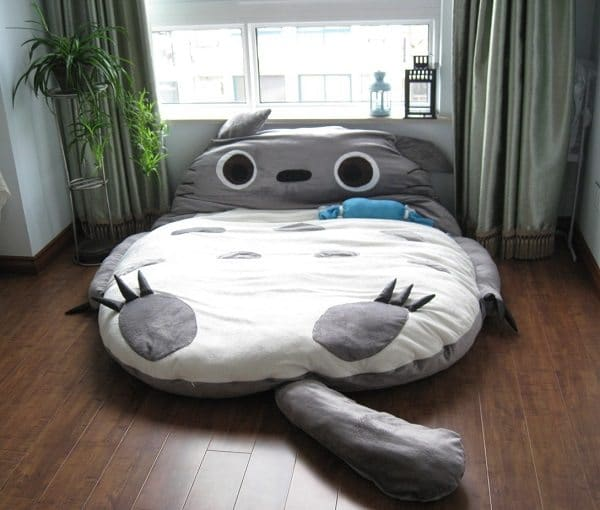 This Fuzzy Giant Will Keep Your Little One Warm At Night. Find It Here:  Totoro Bed