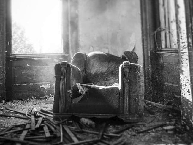 creepy mansion black and white chair