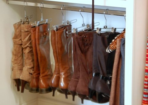 boots hanging on hangers on pole