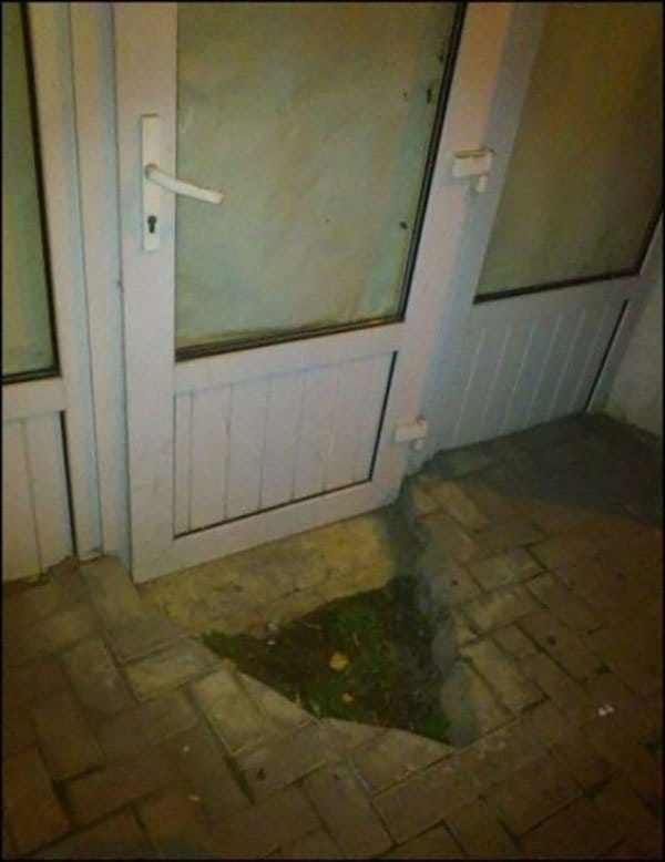broken patio that allows door to open