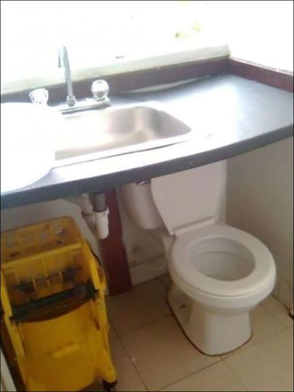 toilet underneath sink basin