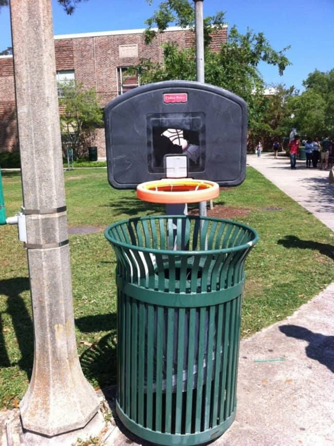 trash can with basketball hoop attached to the top