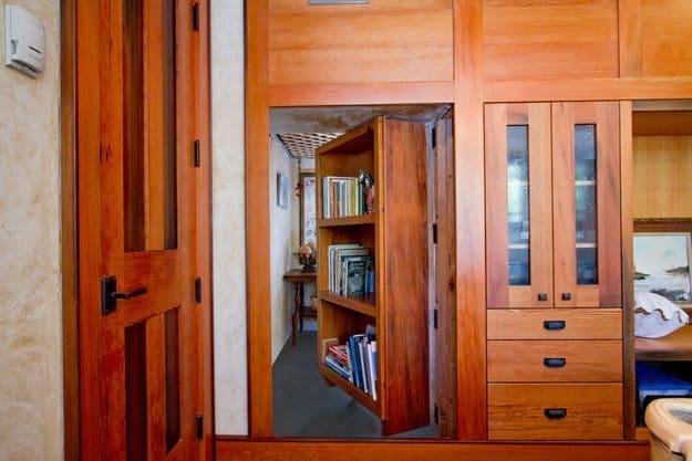 wood bookshelf-door leading to secret room