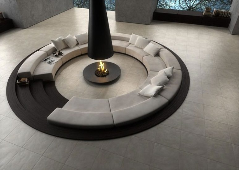 circular sunken pit with gray seating black fire in the middle