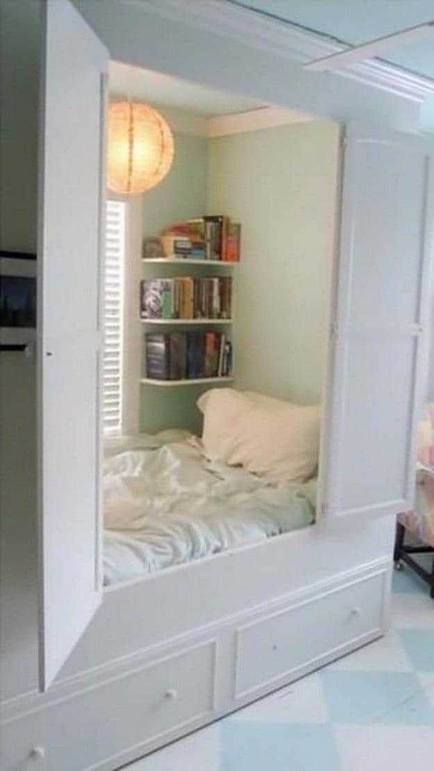 hidden bedding area with shelves inside wardrobe
