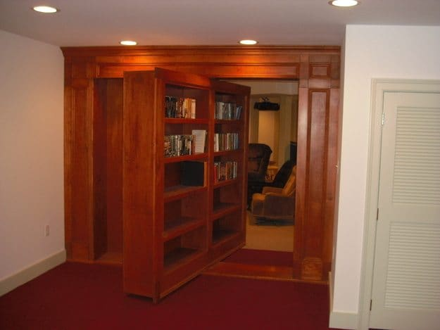 large wooden shelves swiveled open to reveal hidden room