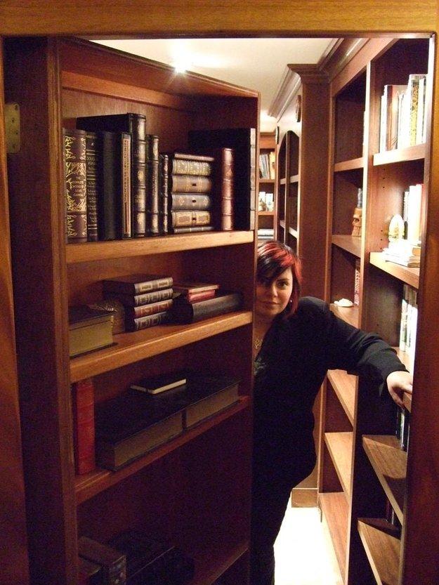 secret bookshelf door leading to hidden library with woman inside