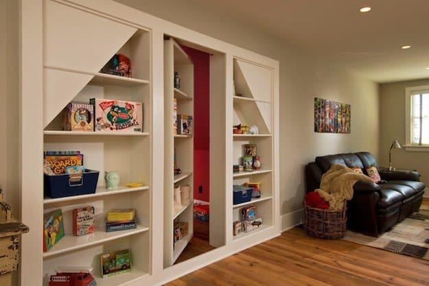 white kids shelves with hidden door to red room