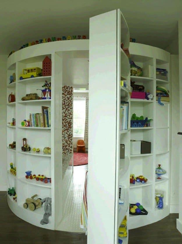 circular white kids shelves leading to hidden rooms