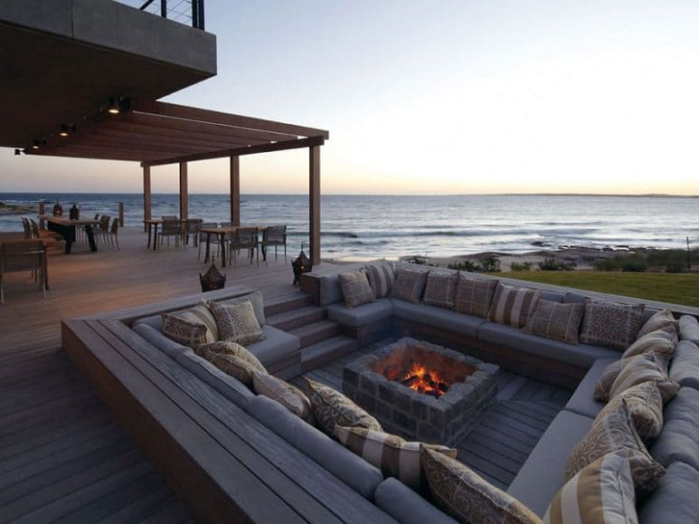 outdoor sunken pit with fire on beachfront