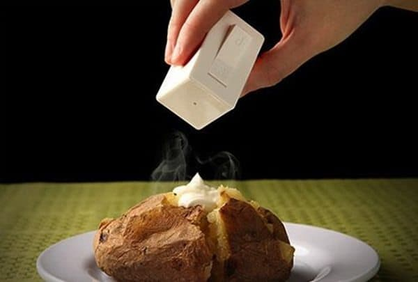 salt and pepper switch device being used on a jacket potato