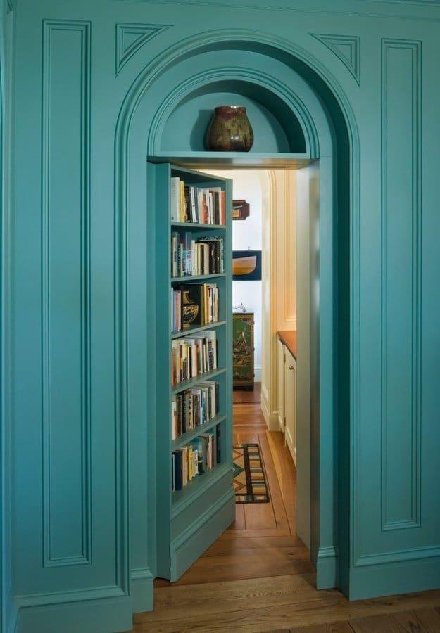 blue bookshelf secret door leading to hidden bathroom
