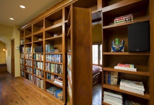 shelves with door leading to secret guest room