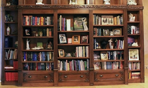 shelves covered in books photos and ornaments