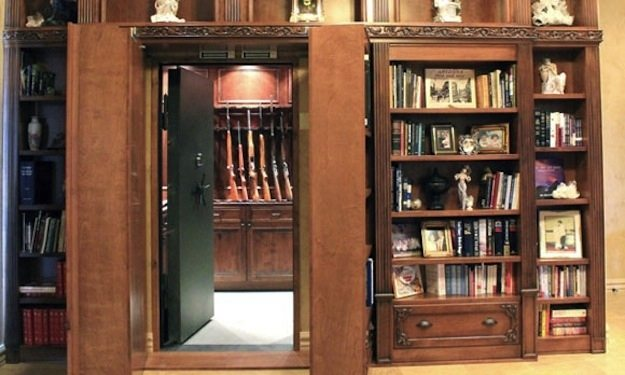 25 hidden room ideas that will give any home a 007 feel to it for How to build a gun vault room