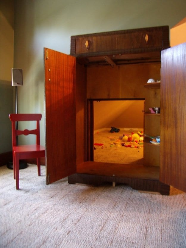 wardrobe opening showing hidden playroom