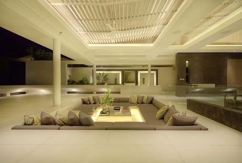 outdoor conversation pit with beige seating white surroundings