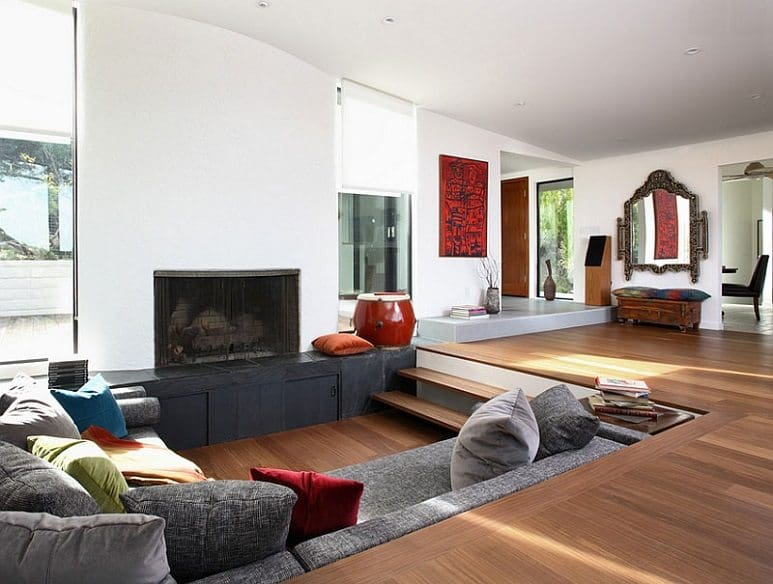 sunken living room square with wood floor and fire place