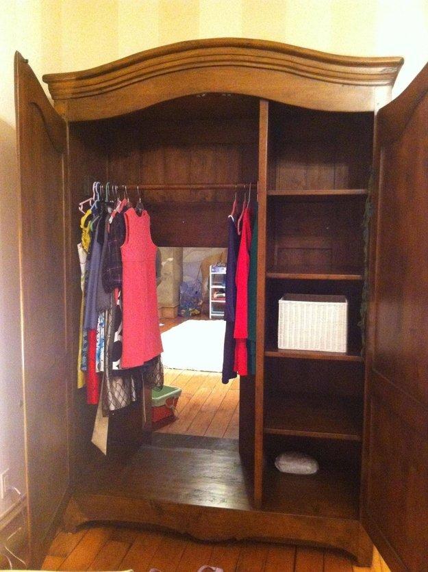 wardrobe opened to show secret passageway