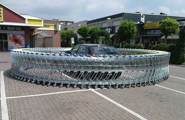 A loop of shopping carts around a car