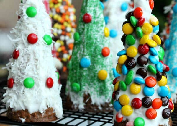 Decorate upside down waffle cones to make Christmas tree desserts