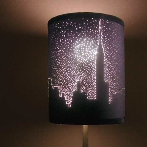 holes in a dark lampshade for a starry effect