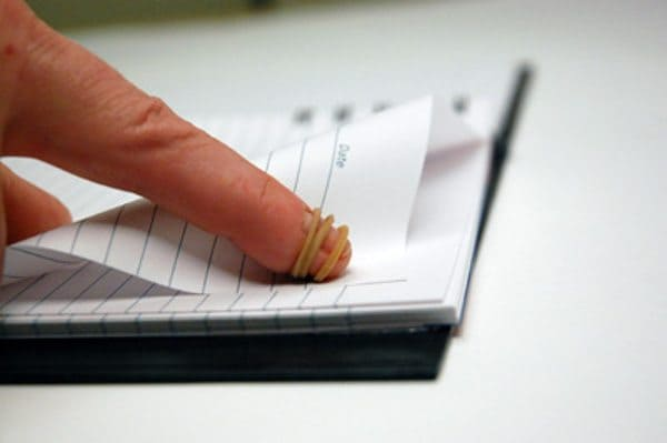 Use a rubber band to help you turn stubborn pages