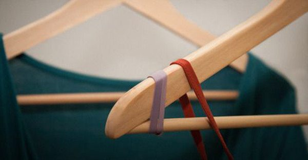 attach rubber bands to hanger ends