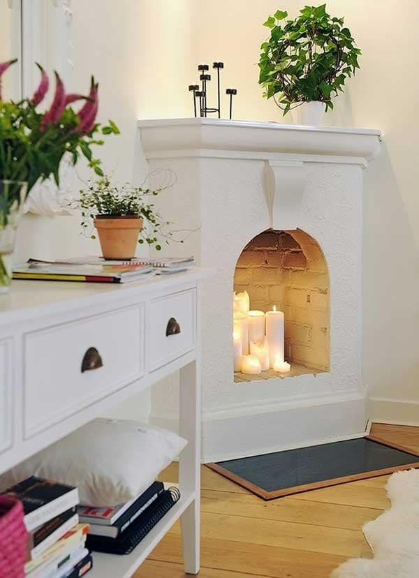 candles-in-fireplace