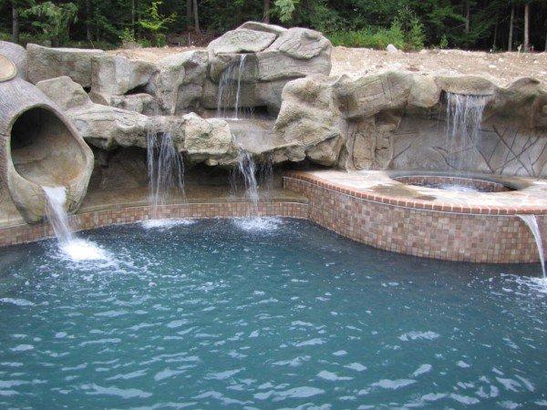 covered slide waterfall hot tub