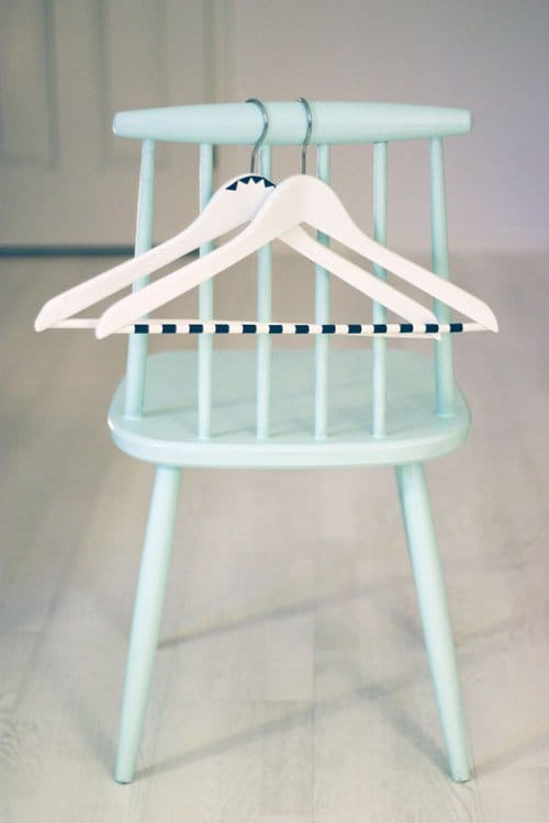 exposed closet or clothing rack use colored tape to prettify hangers