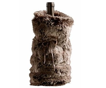 My faux fur wine gift bags were inspired by these from Restoration Hardware. I saw the picture, LOVED the idea, and happened to have a boatload of faux fur fabric left over from my spider dog Halloween costume. I instantly knew exactly how I was going to use up my extra fur fabric. How to Make a Faux Fur Wine Gift Bag.