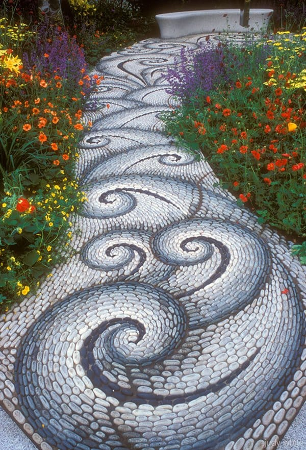 garden-pebble-path-waves-flowers