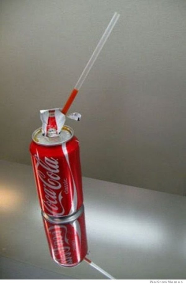 ketchup inside straw inside coca cola can