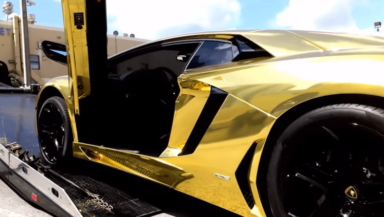 gold lamborghini side view door open
