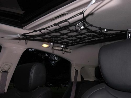mesh bungee tied to roof handles for extra storage