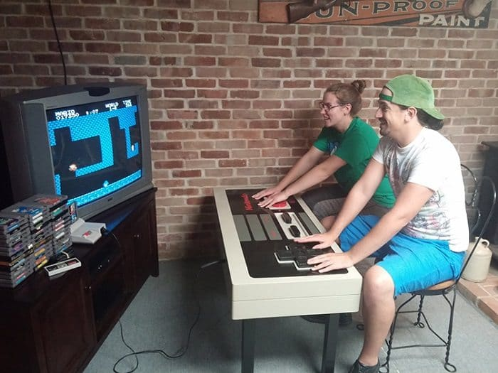 nintendo nes controller coffee table couple playing