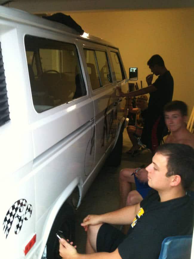 people-decorating-van