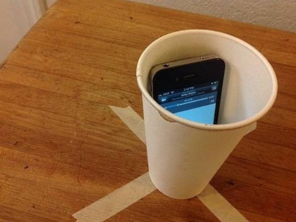 phone in cup amplifies alarm
