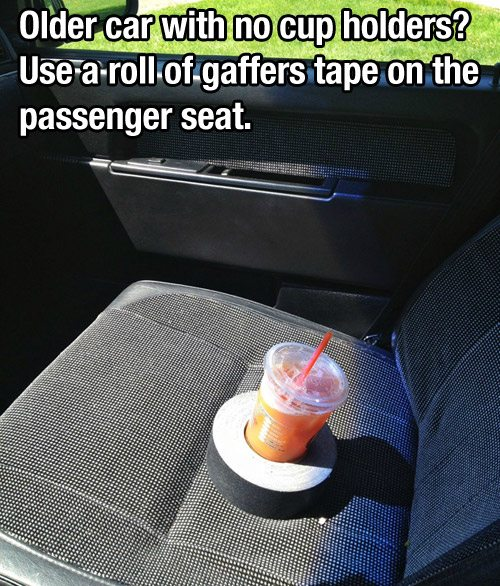 roll of gaffers tape holds drinks in old car