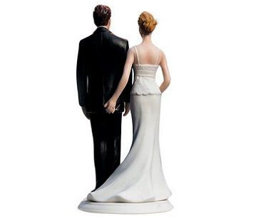 bride pinching groom cake topper