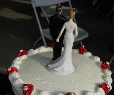 bride pinching groom cake topper wedding