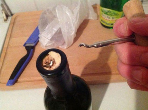 corkscrew broken wine bottle