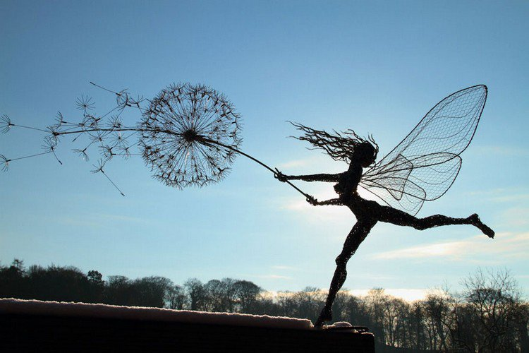 fairy dandelion blowing