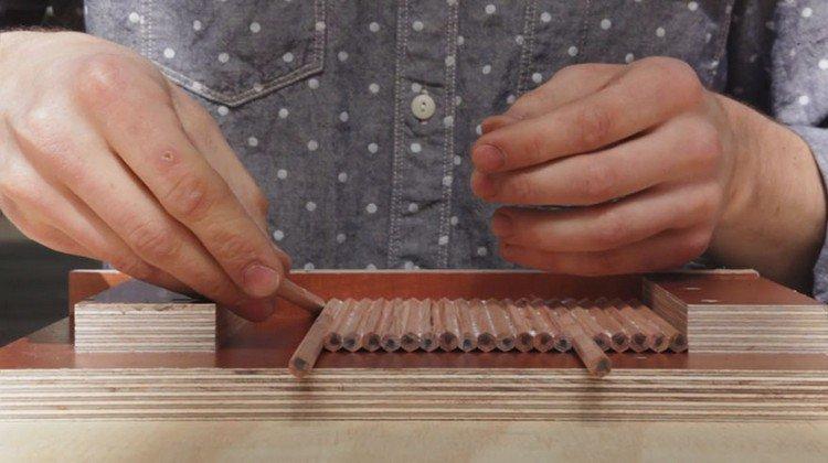 glueing pencils to sheet