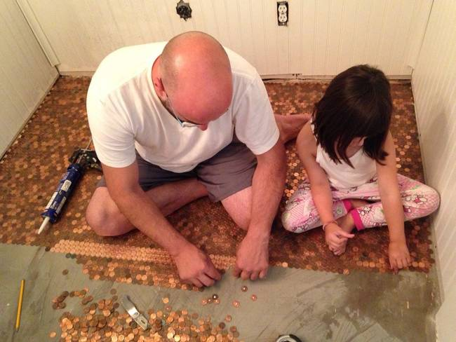man girl laying pennies