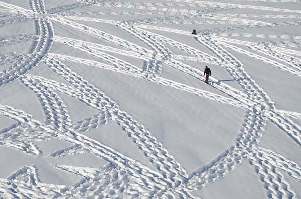 man walking pattern into snow