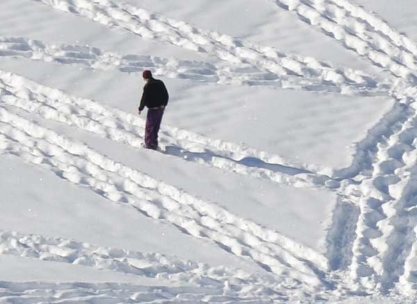 man walking snow