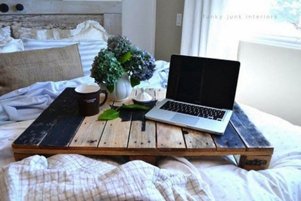 wood pallet bed tray with laptop mug and flowers