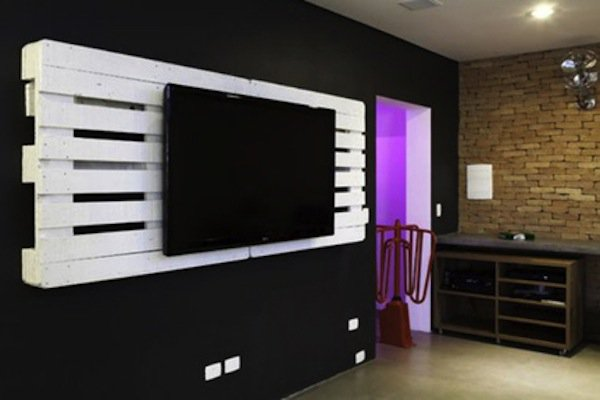 white wood pallet wall mount with tv on it in black room